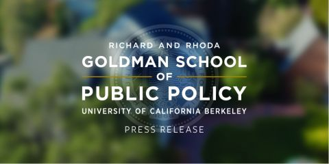 The Goldman School logo is placed upon a blurred image of the Goldman School.
