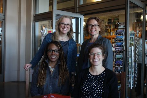 Betsy Baum Block, Corey Newhouse, Justine Wolitzer, and Jamie Allison smile for the camera.