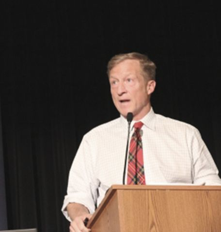 Guest lecturer Tom Steyer speaking at a podium