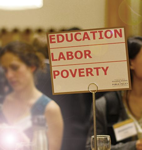 A sign at a networking event with the words Education, Labor and Poverty