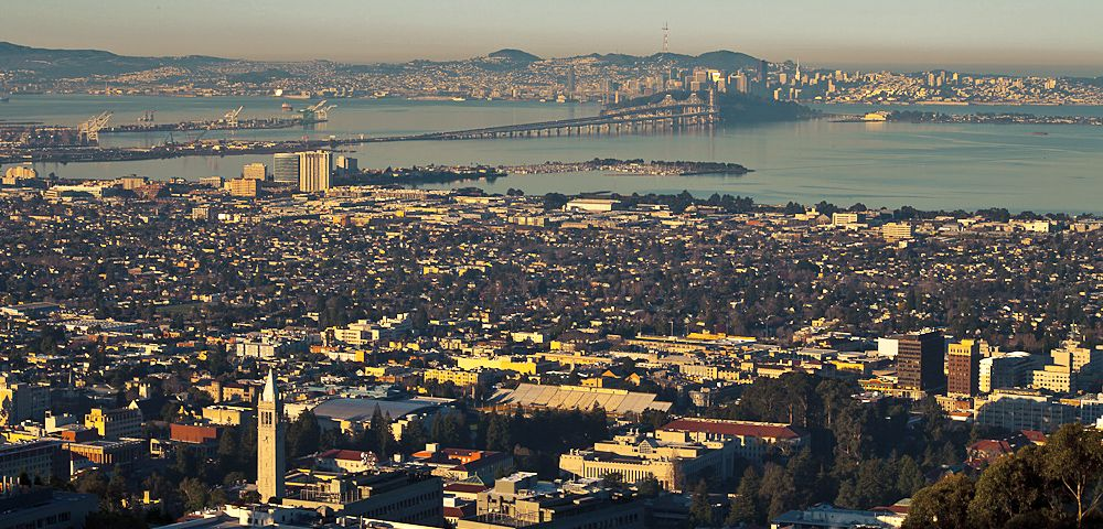 An aerial picture of the UC Berkeley campus extending out to the San Francisco bay